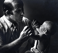 Dr Greenspan with a child